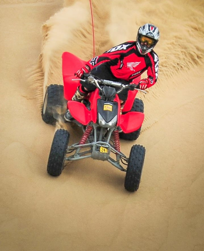 Guest riding downhill on an ATV at Pismo Beach