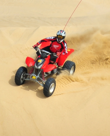 Riding through sand dunes on an ATV trail in Pismo Beach