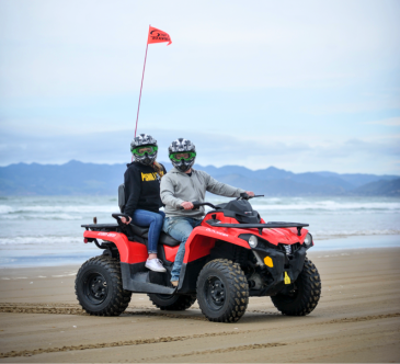 Two guests riding ATVs