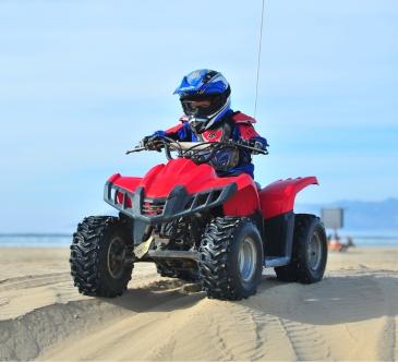 Child riding an ATV