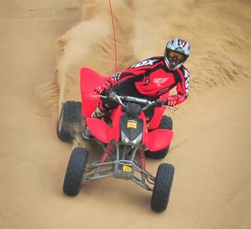 Man riding an ATV downhill