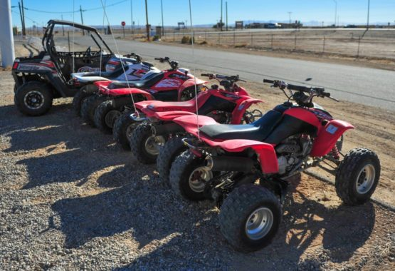 ATVs and UTVs parked in a row