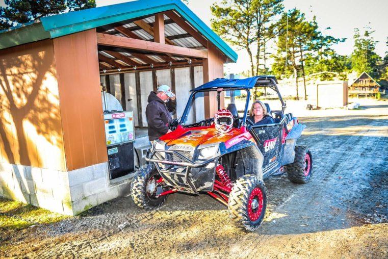 Fueling up a rental at Oregon Dunes Motorsports Service & Parts shop