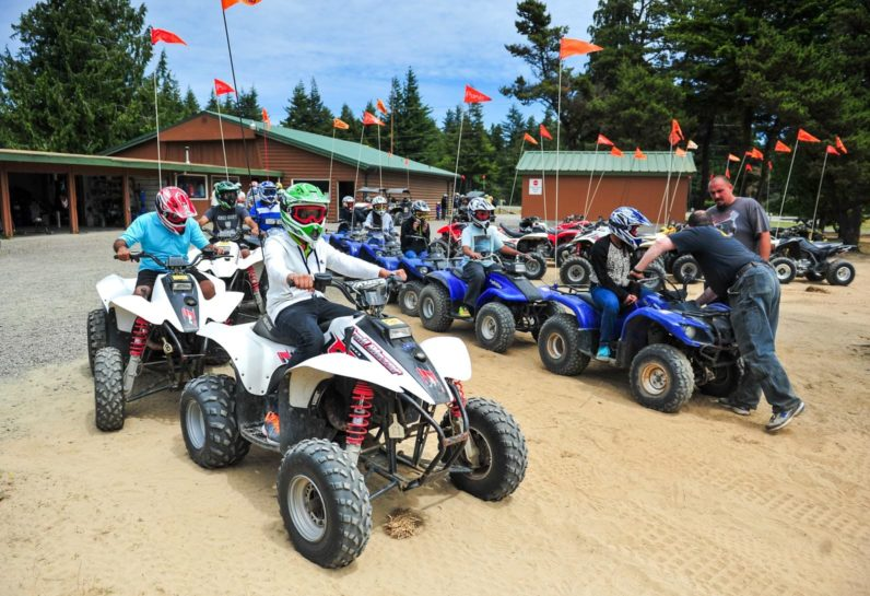 Group of guests sitting on ATV in Oregon, ready to ride