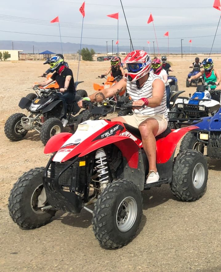 Guests sitting on ATVs, ready to ride at Palm Springs location