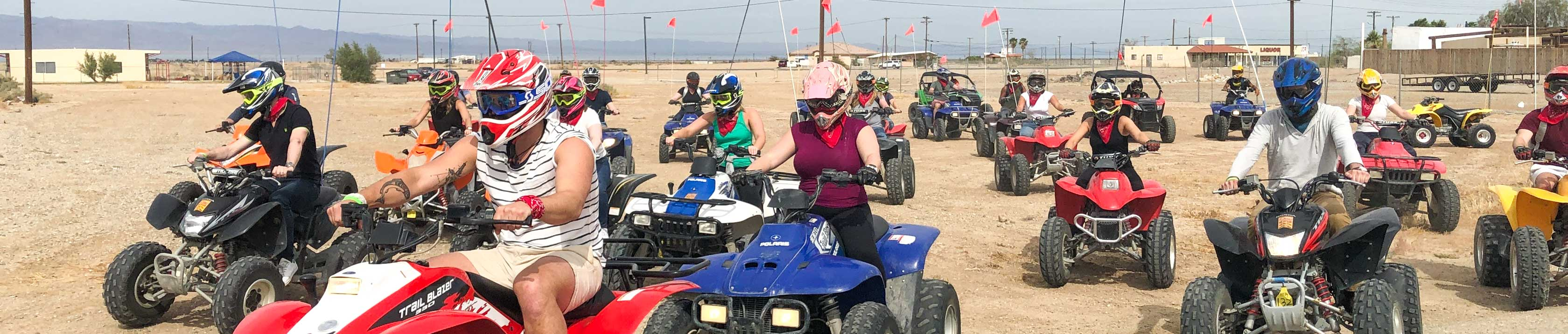 Large group of people riding on ATVs at the beach