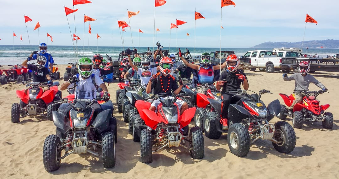 Large group on ATVs at Pismo Beach