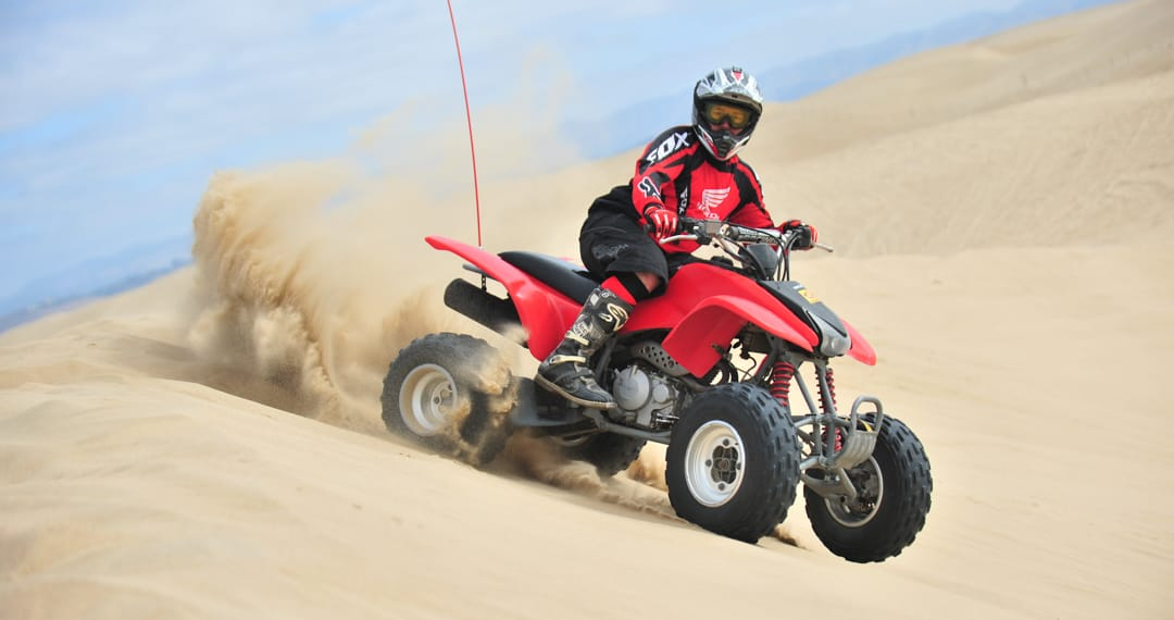 Guest riding on a Honda 400ex on sand dunes