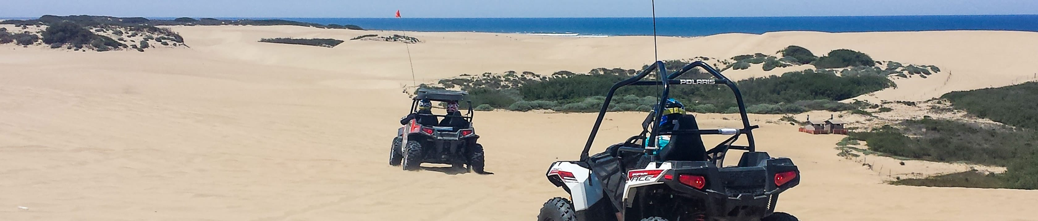 Guests riding in two ATVs