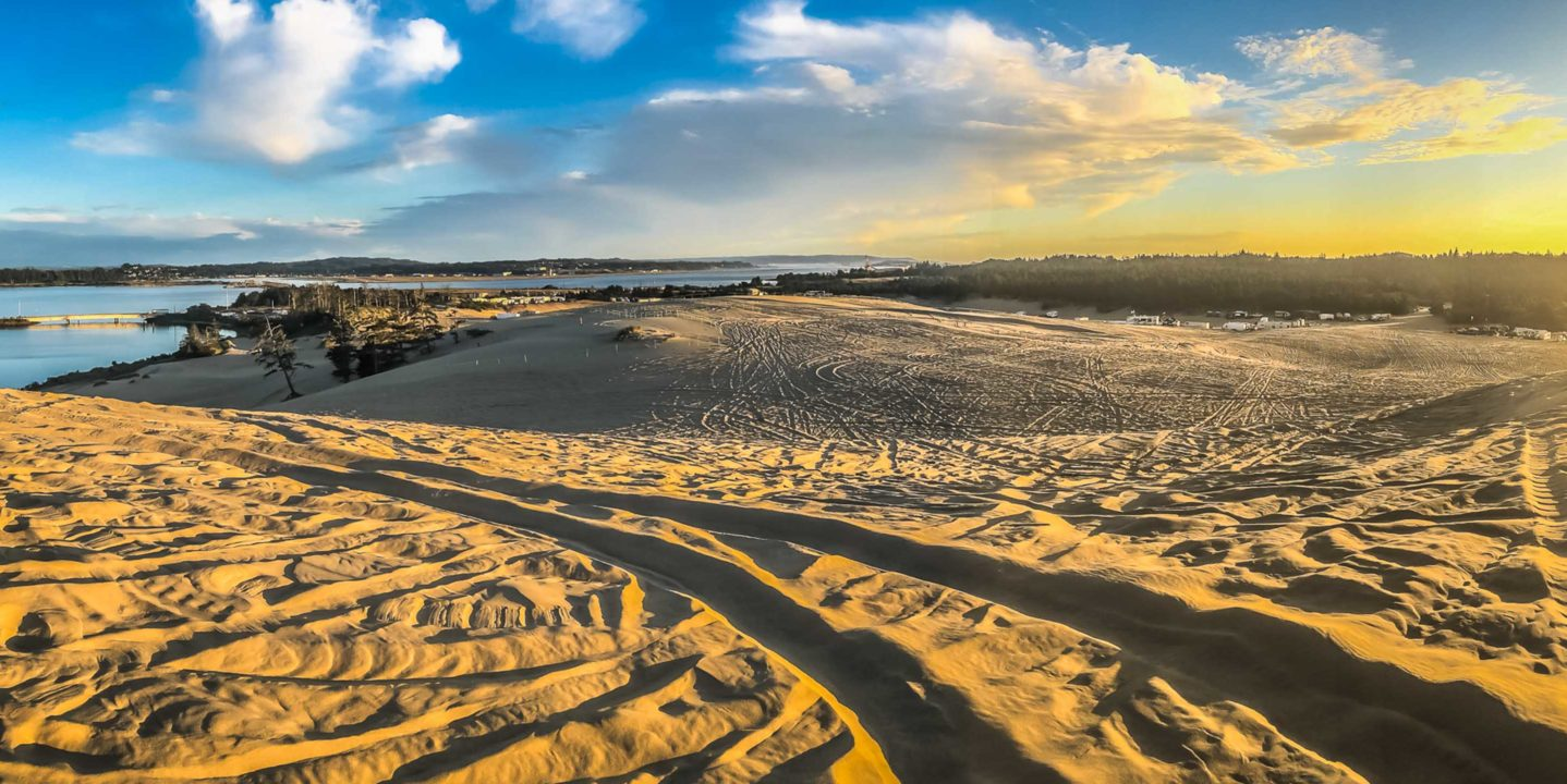 ATV at sunset on dunes in Oregon