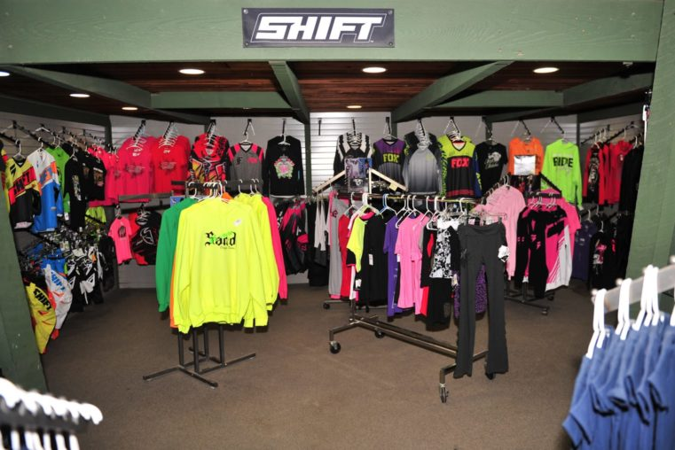Clothing and gear at the Oregon Dunes Motorsports service and parts shop