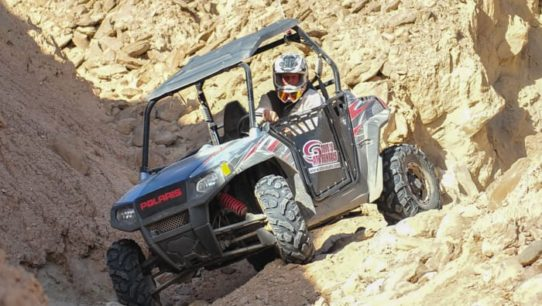 Guest riding an ATV through rocky terrain in Palm Springs
