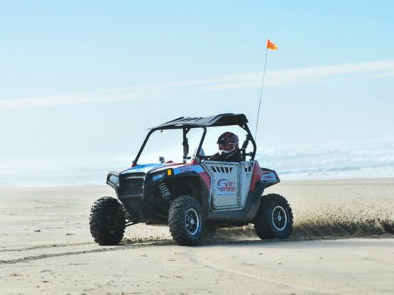 Guest in ATV by the ocean