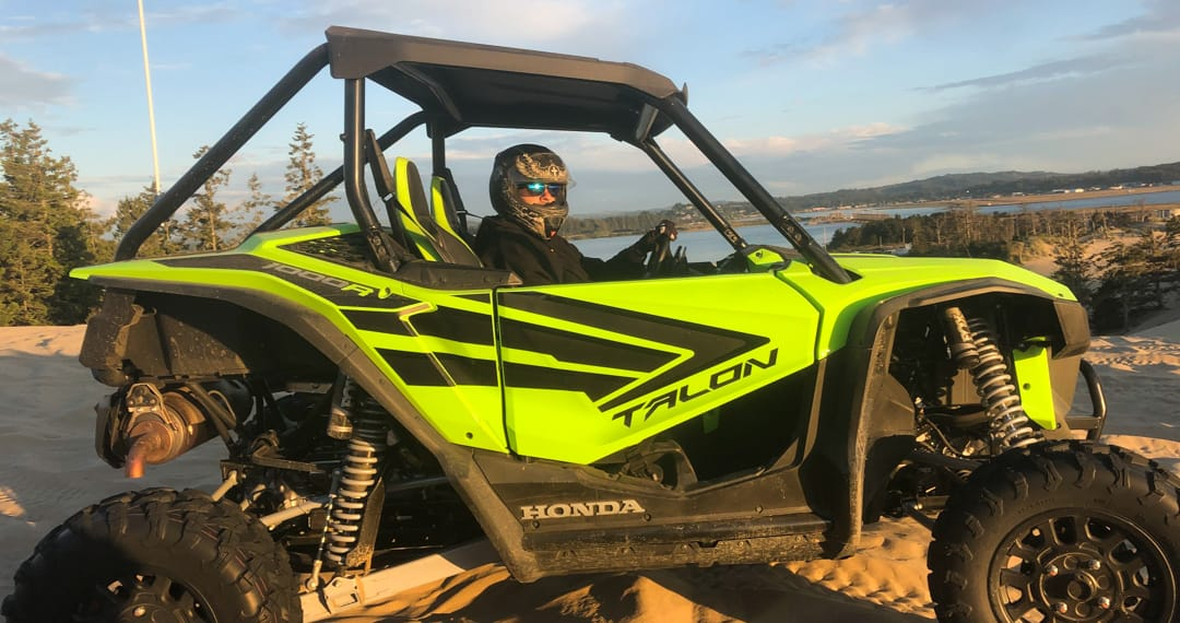 Guest riding in a Honda Talon at sunset in Oregon