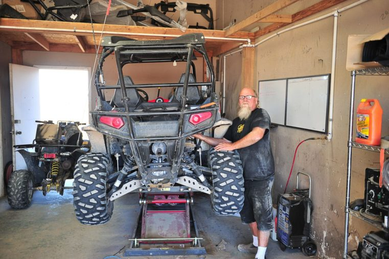 Staff fixing an ATV at the Salton City Offroad service and parts center