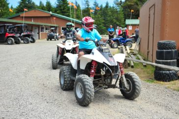 Group of guests riding ATVs in Oregon