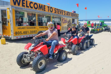 Guests riding on ATVs at Pismo Beach