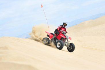 Guest riding an ATV in Pismo Beach